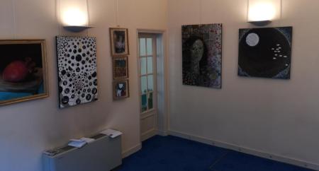 Exposition de tableaux dans le magasin Les Lunettes de François
