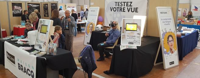 Jean-François et Véronique Bracq, opticiens, organisent une action de prévention lors du Salon « La 25e heure du livre »